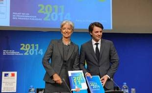 La ministre de l'Economie, Christine Lagarde, et le ministre du Budget, François Baroin, lors d'une conférence de presse à Paris en septembre 2010.