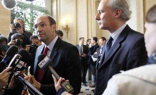 Eric Woerth et Georges Tron à Paris le 12 avril 2010