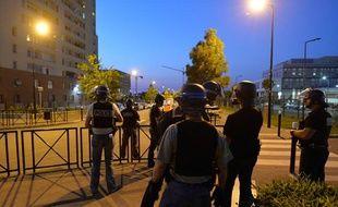 Des policiers patrouillent dans les rues de Trappes, le 20 juillet 2013