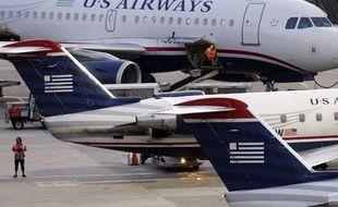Des avions de la compagnie américaine US Airways à l'aéroport de Boston, le 19 juillet 2011.