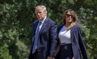 Le président américain Donald Trump et la première dame Melania Trump rentrant à la Maison-Blanche à Washington le 18 juillet 2018.