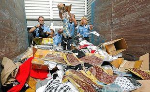 Des dizaines de produits de luxe contrefaits ont été saisis à Lyon. Illustration.