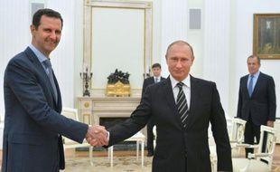 Le président russe Vladimir Poutine et son homologue Bachar al-Assad, le 21 octobre 2015 à Moscou