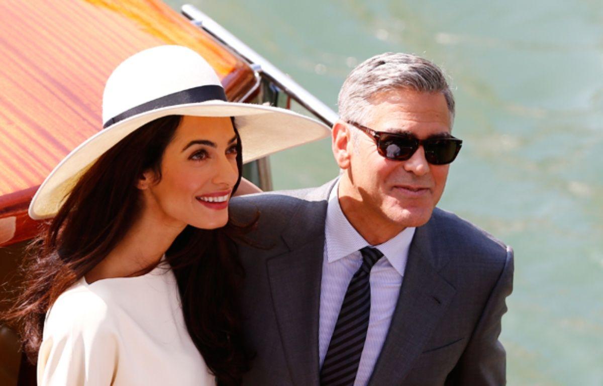 Amal Alamuddin,  épouse de George Clooney, et l'acteur américain, le 29 septembre 2014, à New York. – PIERRE TEYSSOT / AFP