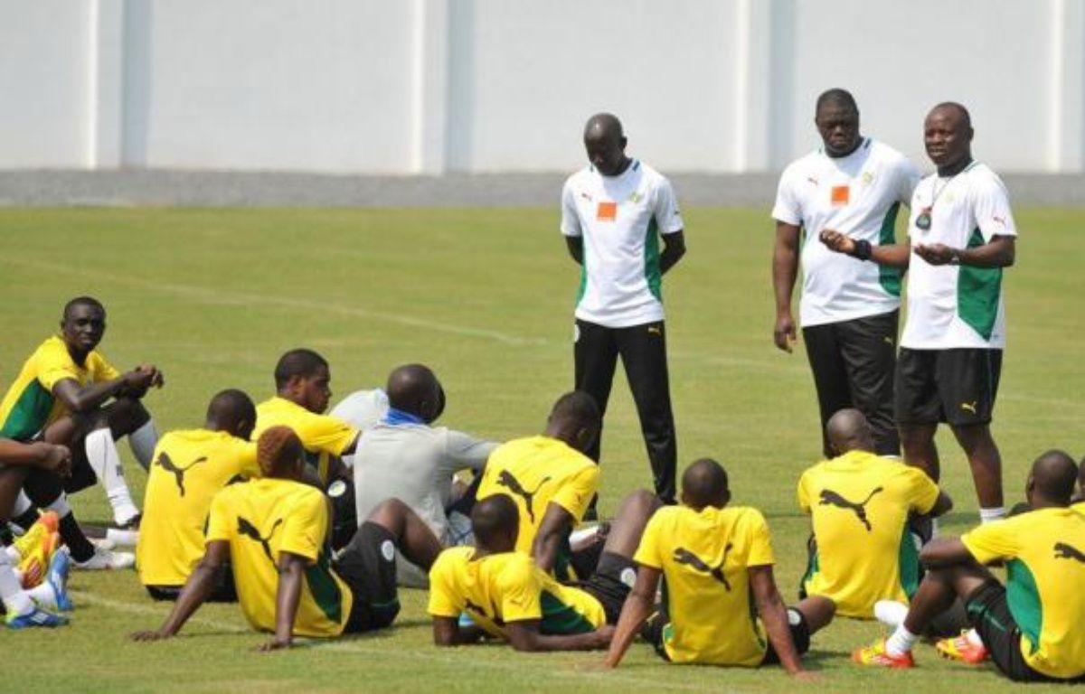 Le Sénégal doit absolument l'emporter contre la Guinée équatoriale mercredi (20h00) à Bata pour relancer dans la course aux quarts de finale, dont la Zambie peut s'approcher contre la Libye (17h00), dans le groupe A de la CAN-2012. – Abdelhak Senna afp.com