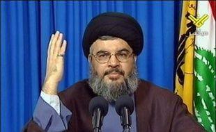 """""""Sionistes, si vous pensez attaquer le Liban, je vous réserve une surprise qui changera le cours de la guerre et le destin de la région"""", a lancé Hassan Nasrallah devant la foule rassemblée dans la banlieue sud chiite de Beyrouth, un des fiefs de son parti."""