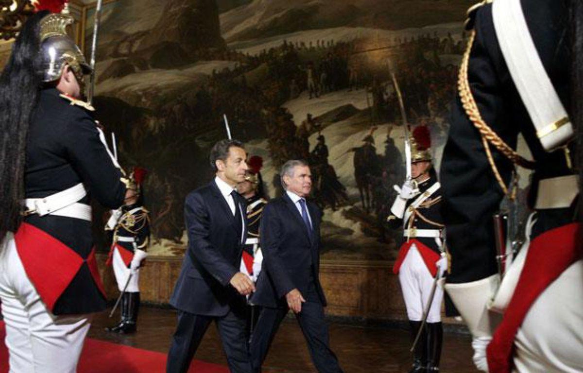 Nicolas Sarkozy arrive avec Bernard Accoyer, président de l'Assemblée nationale, à Versailles où le Parlement est réuni en Congrès, le 22 juin 2009. – DE LA MAUVINIERE/SIPA