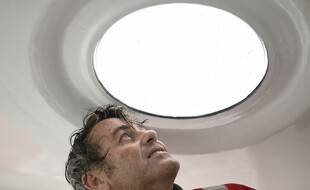 French skipper Yannick Bestaven looks out a porthole as he sails his  Imoca 60 monohull 'Maitre Coq' on October 7, 2020, in the Atlantic ocean off the coast of La Rochelle, western France, a few weeks prior to take the start of the Vendee Globe round-the-world solo sailing race. - The 2020 edition of the Vendee Globe begins on November 8, 2020. (Photo by Sebastien SALOM-GOMIS / AFP)