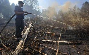 Dans les campagnes russes, la canicule fait des dégâts: les récoltes ont été détruites sur une surface équivalente à celle du Portugal et des feux de forêt se sont déclarés, comme ici près de Shatura, à 130km au sud-est de Moscou, le 19 juillet 2010.