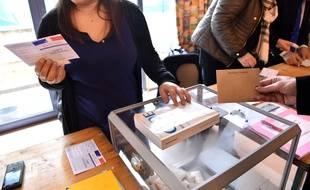 Illustration du vote au premier tour des élections départementales en 2015.