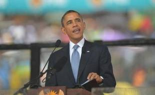 US President Barack Obama gives an address during South African former president Nelson Mandela's memorial service at the FNB Stadium (Soccer City) in Johannesburg on December 10, 2013. Mandela, the revered icon of the anti-apartheid struggle in South Africa and one of the towering political figures of the 20th century, died in Johannesburg on December 5 at age 95. AFP PHOTO / ALEXANDER JOE