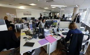 """Des journalistes du département """"Social"""", de l'AFP, le 17 février 2014 à Paris"""