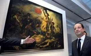 Le président François Hollande a inauguré mardi le musée du Louvre-Lens, posé sur un carreau de mine de l'agglomération la plus pauvre de France, brillant de toute son architecture lumineuse et épurée, et ses chefs-d'oeuvre envoyés par le Louvre.