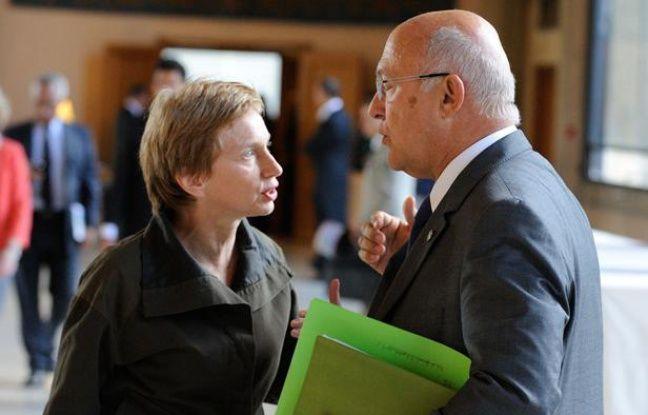 Laurence Parisot, présidente du Medef, et Michel Sapin, ministre du Travail.
