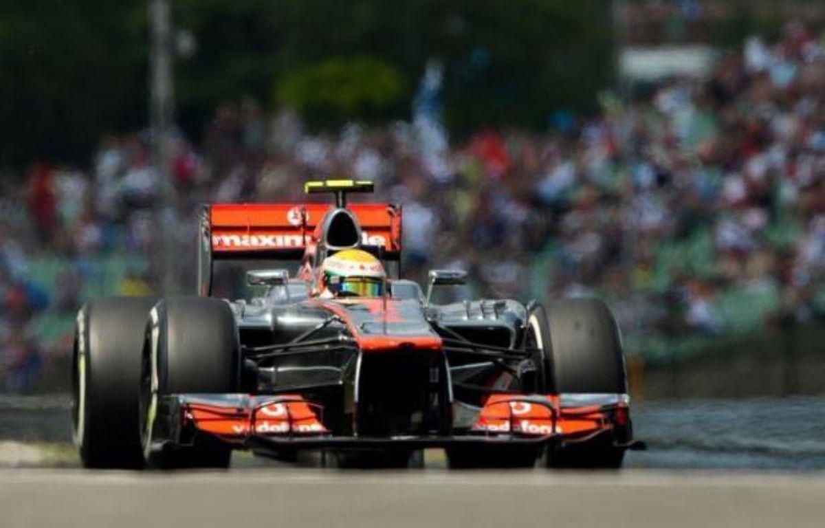 Le Britannique Lewis Hamilton (McLaren) partira en pole position dimanche pour le Grand Prix de Hongrie, 11e manche du Championnat du monde de Formule 1, après avoir signé le meilleur temps des qualifications samedi devant le Français Romain Grosjean (Lotus) – Dimitar Dilkoff afp.com