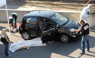 Des policiers sur les lieux où a été tué Adrien Anigo, fils du directeur sportif de l'OM, à Marseille le 5 septembre 2013