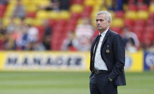 La photo prise au bon moment, avec la bannière Football Manager en fond...