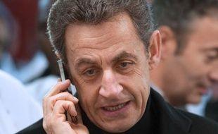 Nicolas Sarkozy au téléphone, en 2012.
