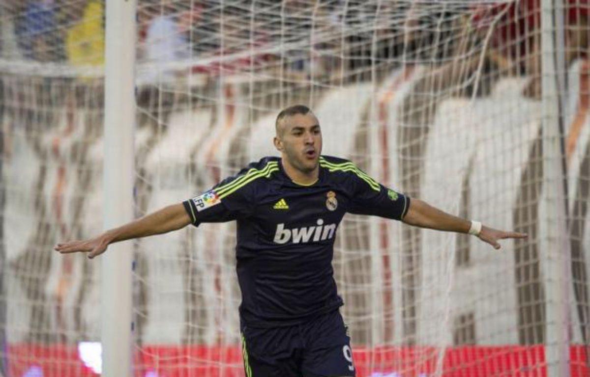 Le Real Madrid s'est imposé sans brio (2-0), grâce à Benzema et Ronaldo, face au Rayo Vallecano, lundi à l'extérieur, pour la 5e journée du championnat d'Espagne, revenant ainsi à 8 points du FC Barcelone, leader du classement après son sans-faute de 5 victoires en autant de matches. – Dani Pozo afp.com