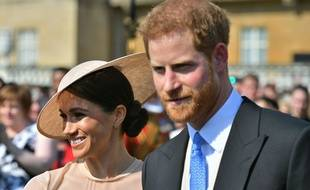 Meghan Markle et le prince Harry lors de la garden-party à Buckingham Palace le 21 mai 2018