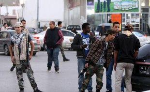 Assaillies de revendications de toutes parts, les nouvelles autorités libyennes peinent à régler la question des milices, en charge d'une grande partie de la sécurité du pays depuis la guerre et qui réclament désormais d'être représentées dans les instances dirigeantes.