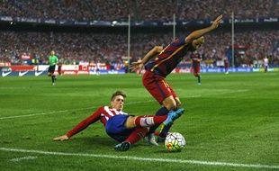 Fernando Torres au duel avec Mascherano, le 12 septembre 2015.