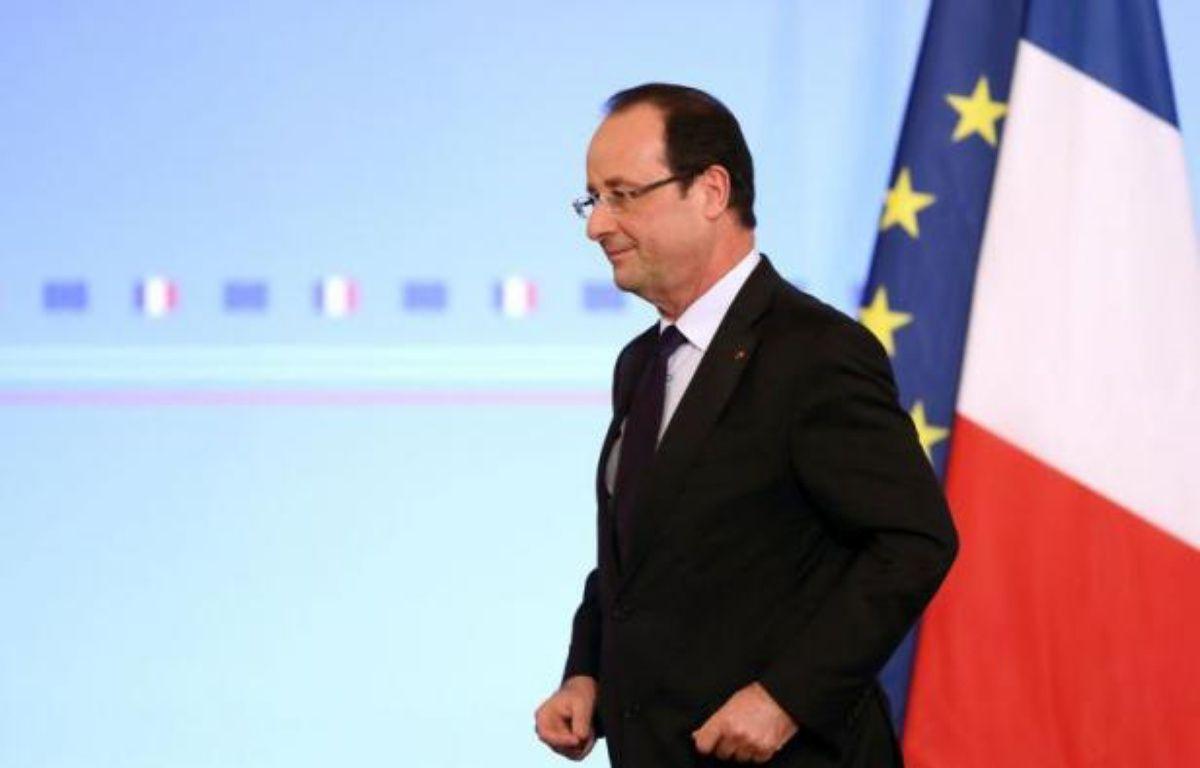"""Le président François Hollande a appelé vendredi à un """"sursaut"""" de tous face aux menaces de réchauffement climatique et de disparition de la biodiversité, qu'il a décrites avec gravité et insistance devant les ambassadeurs. – Philippe Wojazer afp.com"""