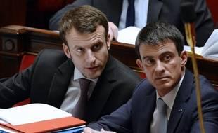 Emmanuel Macron et Manuel Valls à l'Assemblée nationale.  AFP PHOTO / ALAIN JOCARD