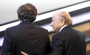 Swiss FIFA President Joseph Blatter, right, and French UEFA President Michel Platini walk together at the 61st FIFA Congress in Zurich, Switzerland, Wednesday, June 1, 2011. (AP Photo/Michael Probst)/PZUR119/1106011452