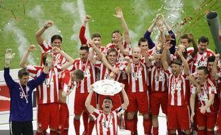 Les joueurs du Bayern Munich, fêtant leur titre de champion, le 8 mai 2010 sur la pelouse de Berlin.