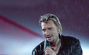 Johnny Hallyday en 1998 au Stade de France, dans un concert dirigé par Yvan Cassar.
