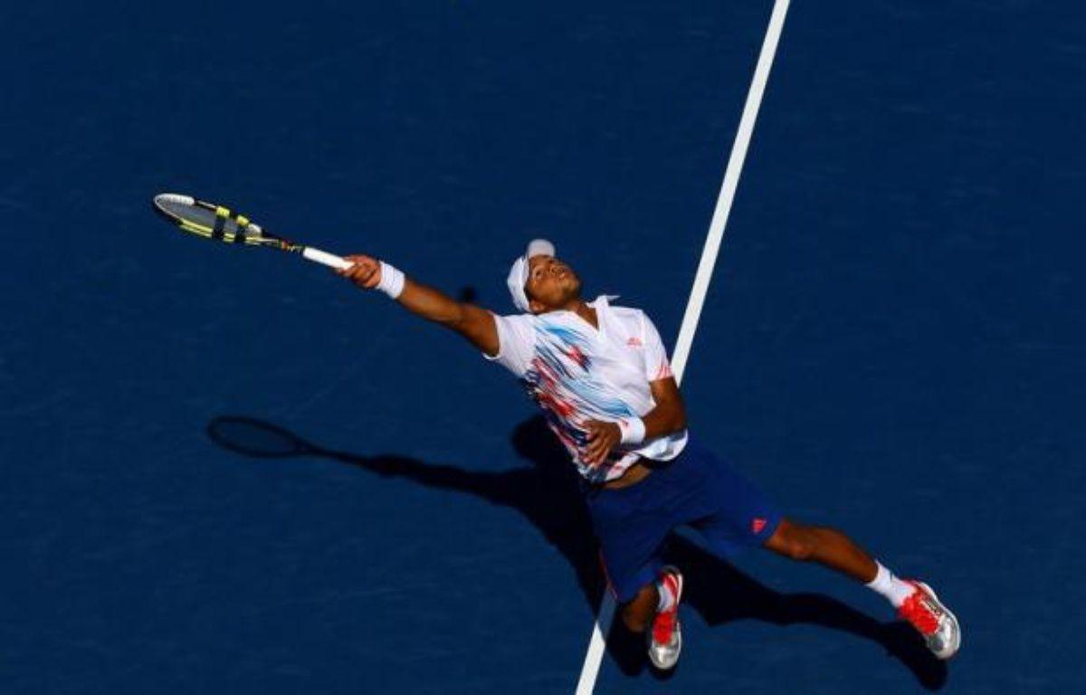 Jo-Wilfried Tsonga et Julien Benneteau, qui ont apporté à la France deux de ses 34 médailles des Jeux de Londres, ont fait une entrée en matière convaincante et assez similaire mardi à l'US Open. – Al Bello afp.com