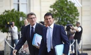 Manuel Valls et Vincent Peillon, à l'époque où ils étaient encore membres du gouvernement, le 19 août 2013