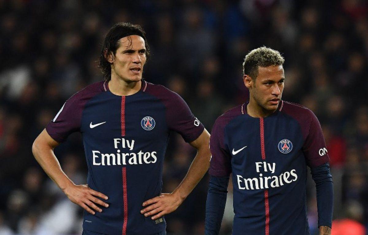 Edinson Cavani et Neymar lors de PSG-Lyon, le 17 septembre 2017 au Parc des Princes.  – FRANCK FIFE / AFP