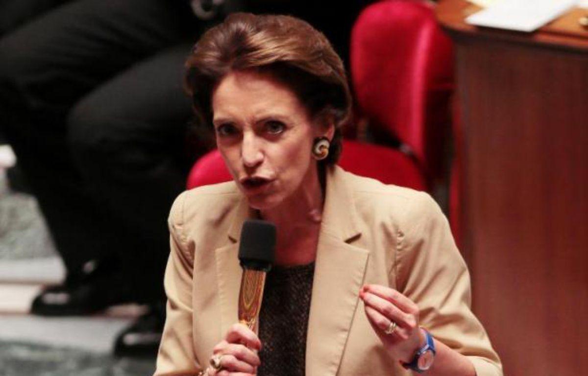 """Les députés français votent mardi en première lecture le projet de loi sur les retraites sous le regard de syndicats et de salariés opposés à la réforme, appelés à se rassembler devant l'Assemblée nationale pour dire qu'ils """"n'abandonnent pas"""". – Jacques Demarthon AFP"""