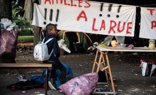 175 migrants ont été évacués du parc de la Villette à Paris, le 28 août 2019, où ils s'étaient installés la veille.