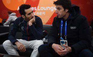 Martin Fourcade et Tony Estanguet en discussion lors des JO de Pyeongchang, le 19 février 2018.