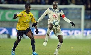 Alou Diarra (ici au côté du Sochalien Modibo Maïga) souhaiterait que les Girondins se renforcent cet hiver.