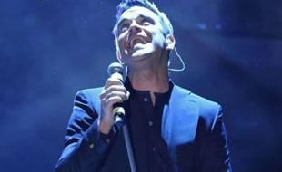 Robbie Williams en concert au 61e festival de musique de Sanremo, en Italie, le 18 février 2011