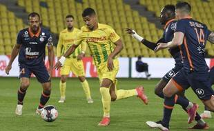 Nantes' French midfielder Ludovic Blas runs with the ball during the French L1 football match between Nantes (FC Nantes) and Montpellier Herault SC at La Beaujoire Stadium in Nantes, western France on May 23, 2021. (Photo by Sebastien SALOM-GOMIS / AFP)