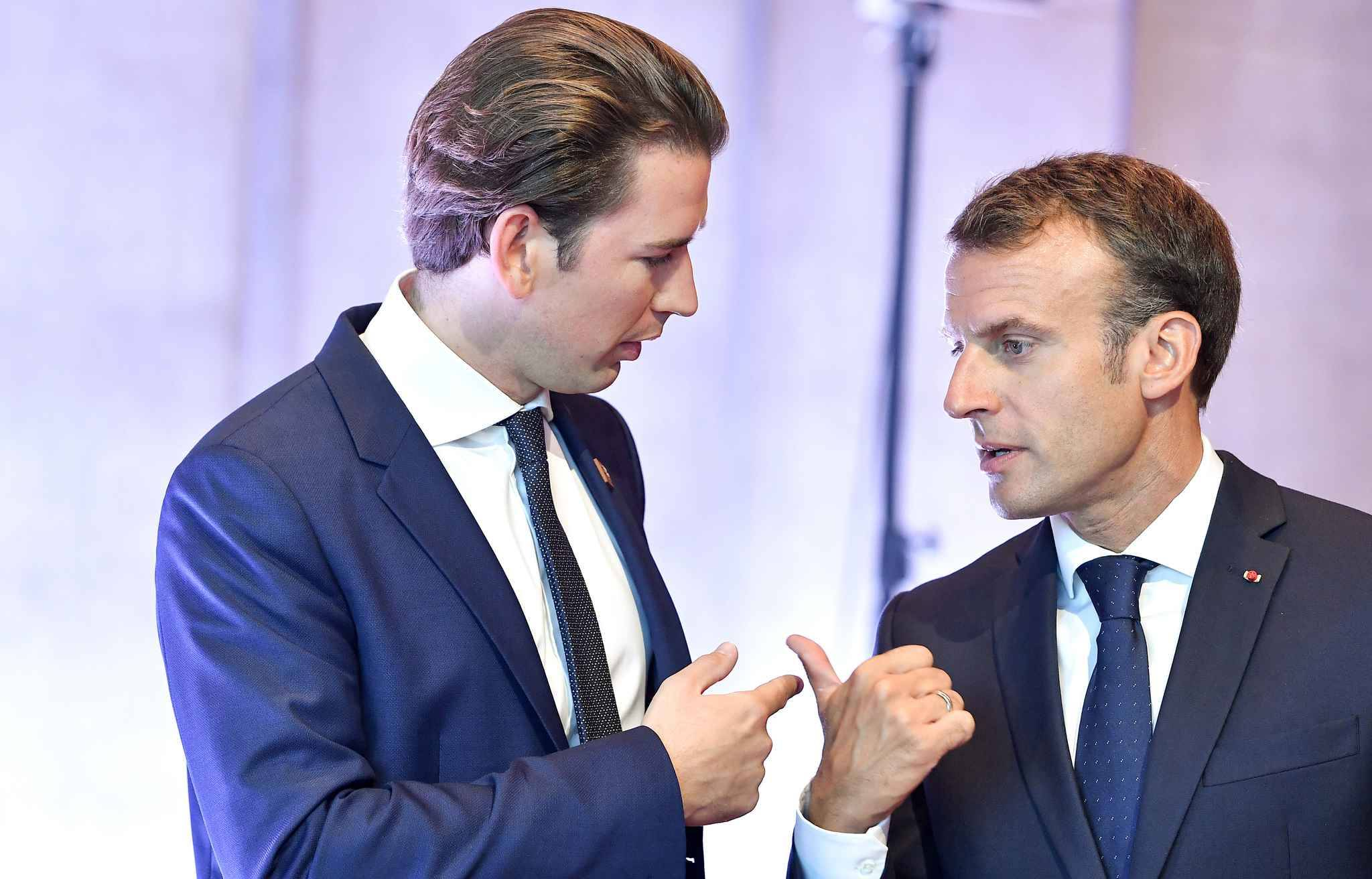 Austria's Chancellor Sebastian Kurz (L) and France's President Emmanuel Macron confer prior to the start of a plenary session at the Mozarteum University during the EU Informal Summit of Heads of State or Government in Salzburg, Austria, on September 20, 2018.