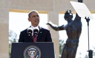 Barack Obama a rendu hommage aux soldats américains tombés sur les plages de Normandie en 1944, le 6 juin 2014 à Colleville (Calvados).