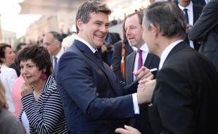 """Claude Bartolone et Arnaud Montebourg, réunis à la Fête de la Rose de Frangy-en-Bresse, ont joué """"l'unité"""" et le """"rassemblement"""" derrière l'exécutif, écartant les critiques de Jean-Luc Mélenchon et défendant le ministre de l'Intérieur, Manuel Valls."""