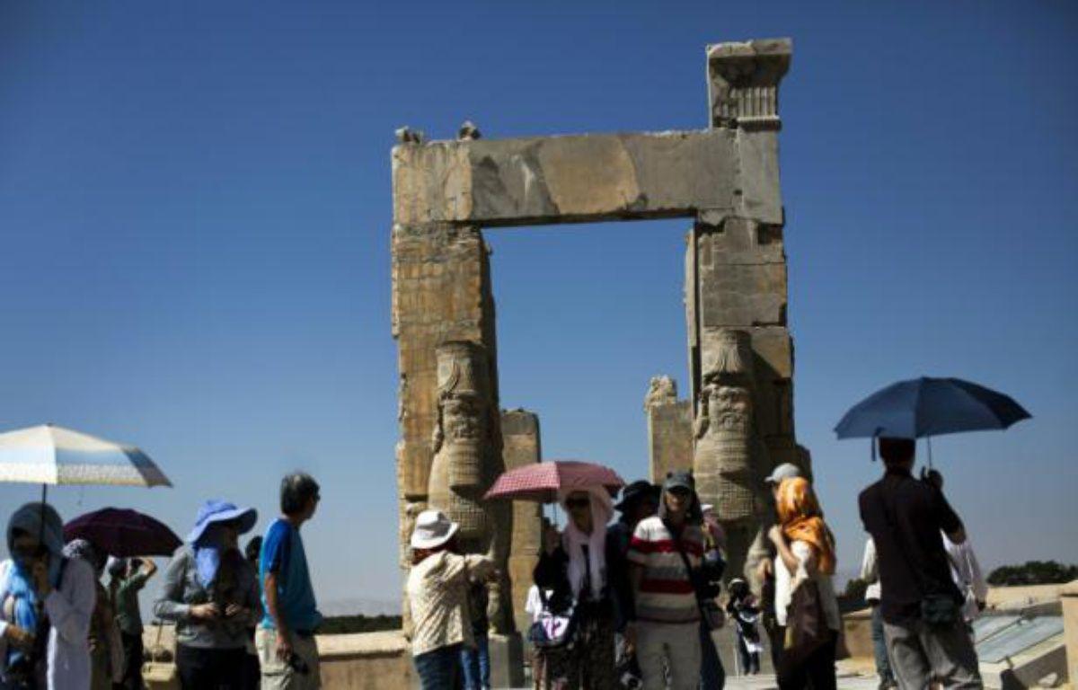 Des touristes chinois de Hong Kong à Persépolis, l'ancienne cité Perse près de Shiraz en Iran, le 26 septembre 2014 – BEHROUZ MEHRI AFP