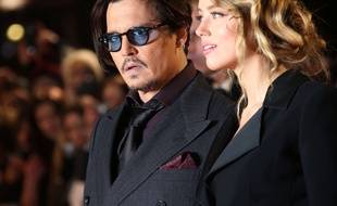 Actor Johnny Depp and Amber Heard pose for photographers upon arrival at the premiere of the film Mortdecai, in London, Monday, Jan. 19, 2015. (Photo by Joel Ryan/Invision/AP)/LENT101/529546068320/011915110197, 21334631/1501200038