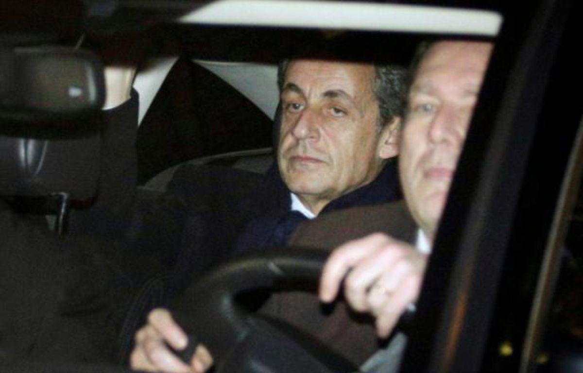 L'ancien président Nicolas Sarkozy quitte le pôle financier à Paris, le 16 février 2016, après sa mise en examen pour financement illégal de sa campagne présidentielle de 2012 – Geoffroy Van der Hasselt AFP