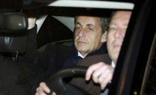 L'ancien président Nicolas Sarkozy quitte le pôle financier à Paris, le 16 février 2016, après sa mise en examen pour financement illégal de sa campagne présidentielle de 2012