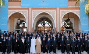 """L'opposition au régime syrien de Bachar al-Assad a reçu mercredi le soutien de poids des Arabes et des Occidentaux qui l'ont reconnue comme le """"représentant légitime"""" du peuple syrien, son chef recevant une invitation officielle à se rendre à Washington."""