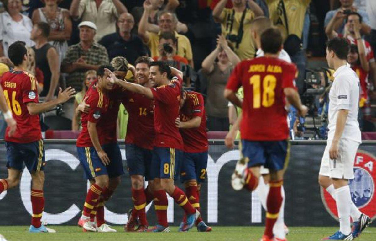Les joueurs espagnols fêtent leur 2e but face à la France, en quart de finale de l'Euro 2012, le 23 juin 2012, à Donetsk (Ukraine). – M.BUHOLZER / REUTERS