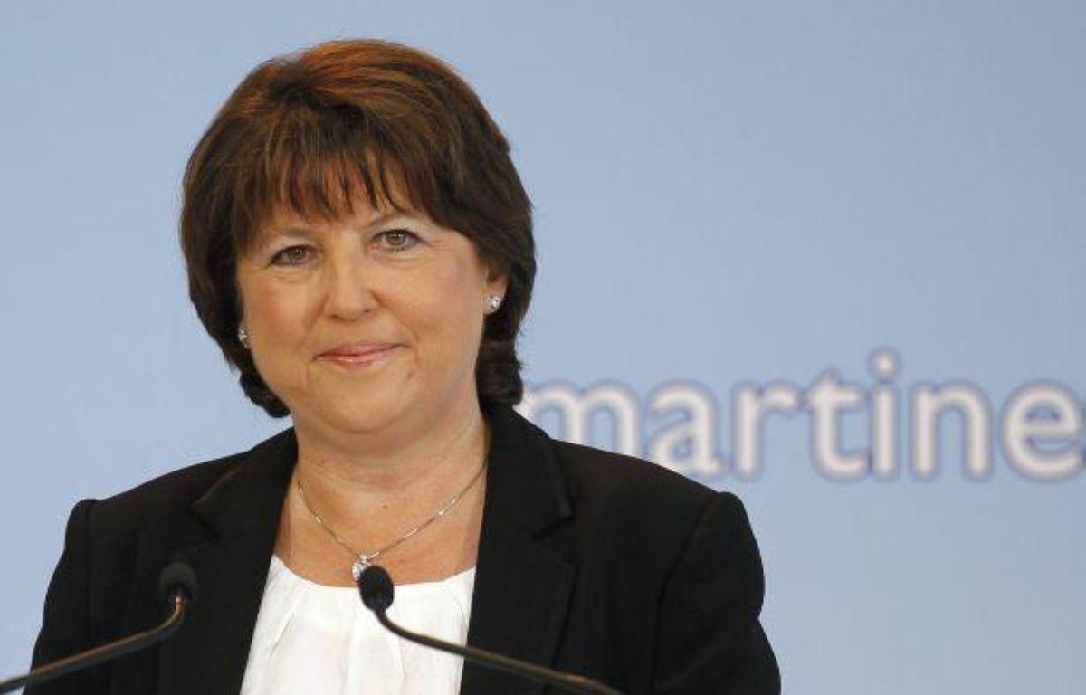 La Première secrétaire du Parti socialiste, Martine Aubry, lors d'annonce de sa candidature aux primaires socialistes à Lille, le 28 juin 2011. – B.TESSIER / REUTERS